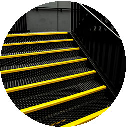 industrial stair case with yellow safety tape